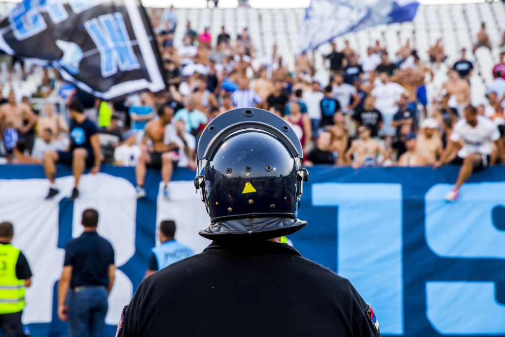 policeman with helmet guarding a sport event